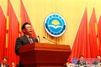 梁稳根在「中国工商联第十二次全国代表大会」宣读倡议书